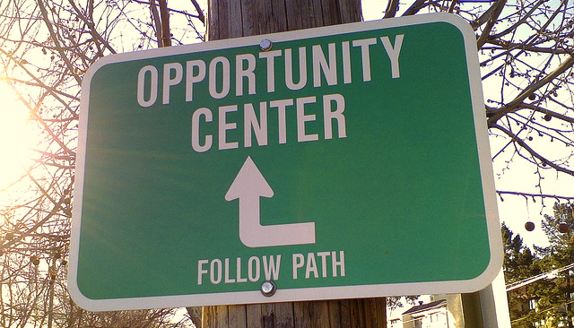 green opportunity center sign on a tree
