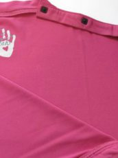 pink baby clothes with white hand prints on them