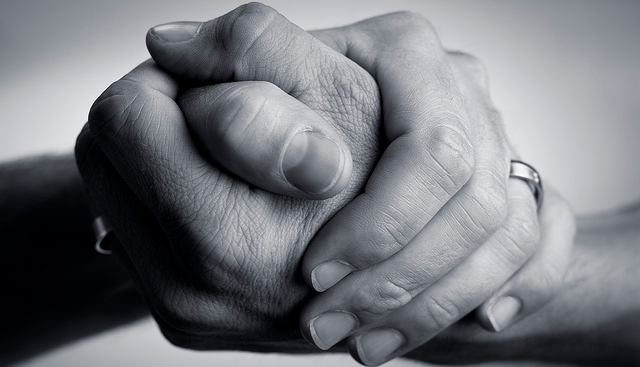 black and white photo of two clasped hands
