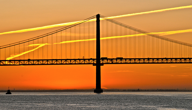 silhouette of a bridge with orange sunset background