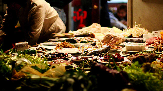 table full of plates of different ingredients