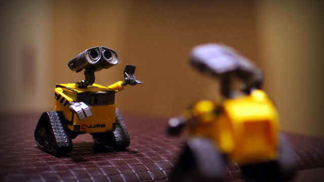 tiny yellow robots walle staring at each other