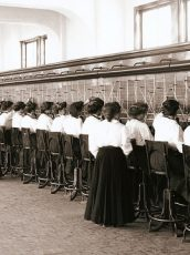 old photo of a line of woman working as telephone operators