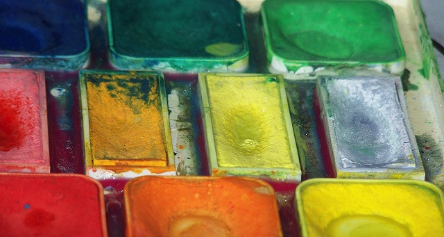 watercolor paint pots in rainbow colors