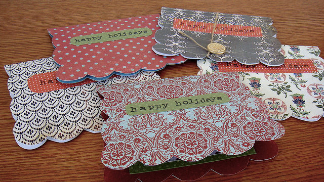 happy holiday cards with red and white designs