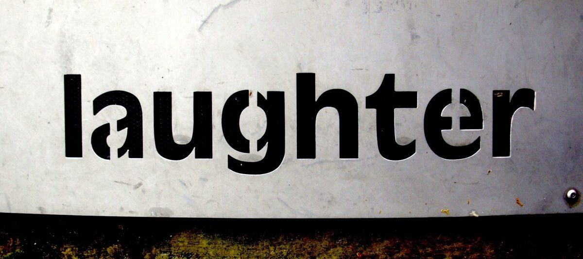 sign that says laughter