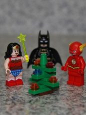 lego character around a lego christmas tree
