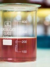red liquid in a scientific beaker