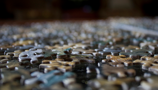 puzzle pieces laying on a table