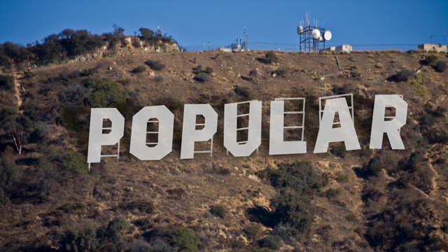 hollywood sign style letters in a hill spelling out popular