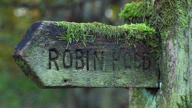 forest robin hood sign covered in moss