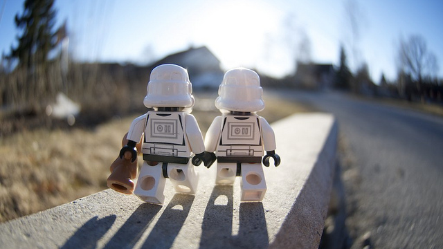 two lego star wars characters walking together
