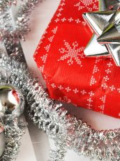wrapped presents with bows on top and silver tinsel