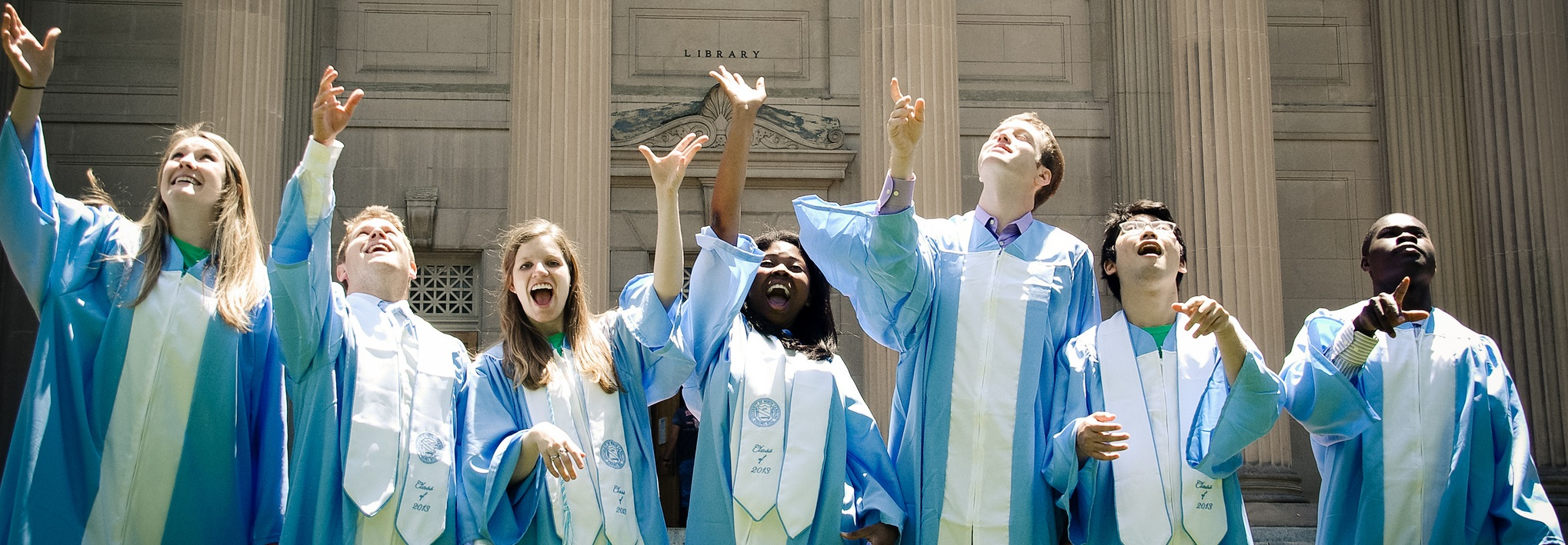 Columbia graduates in caps and gowns celebrating
