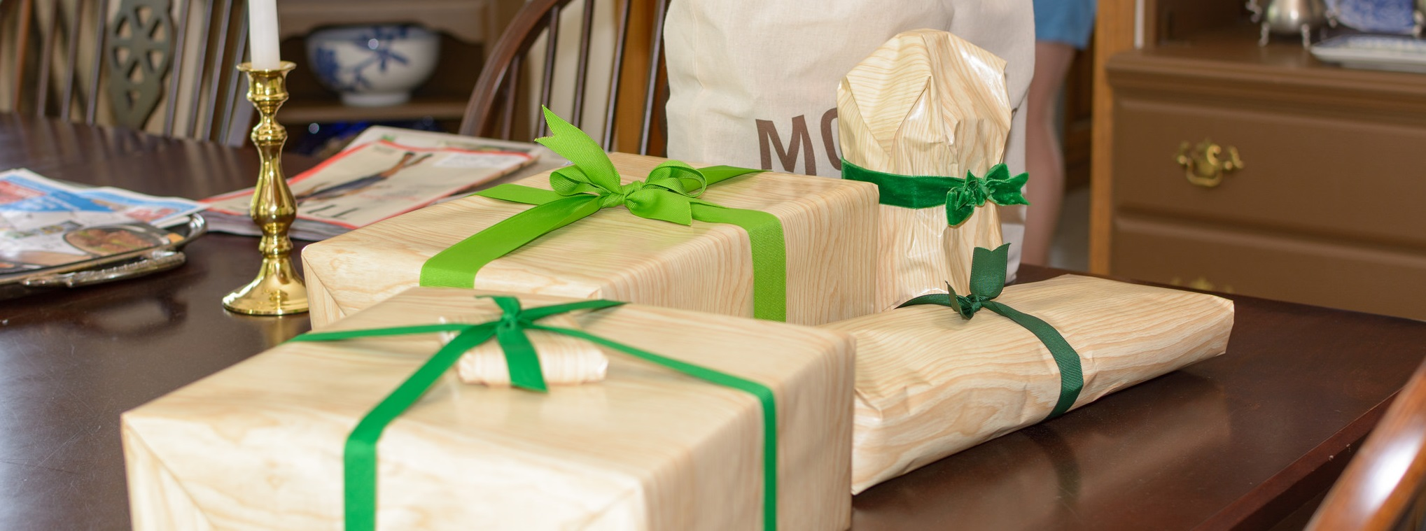 gift wrapped in brown wrapping paper with green ribbons