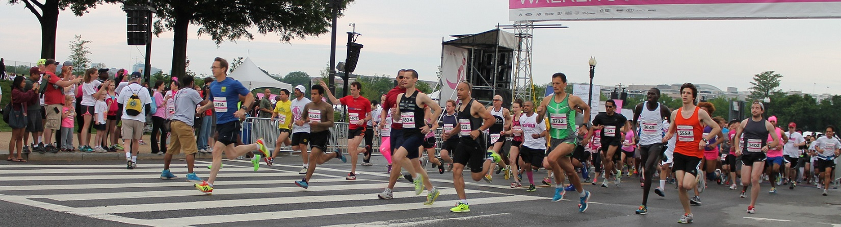 runners participating in a Breast Cancer awareness fundraising event