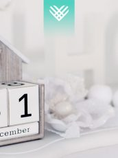box calendar reading December 31 and white holiday decorations