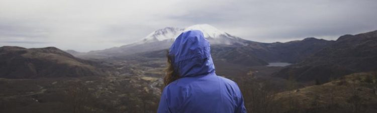 Image of hiker facing fear of failure in the form of a mountain.