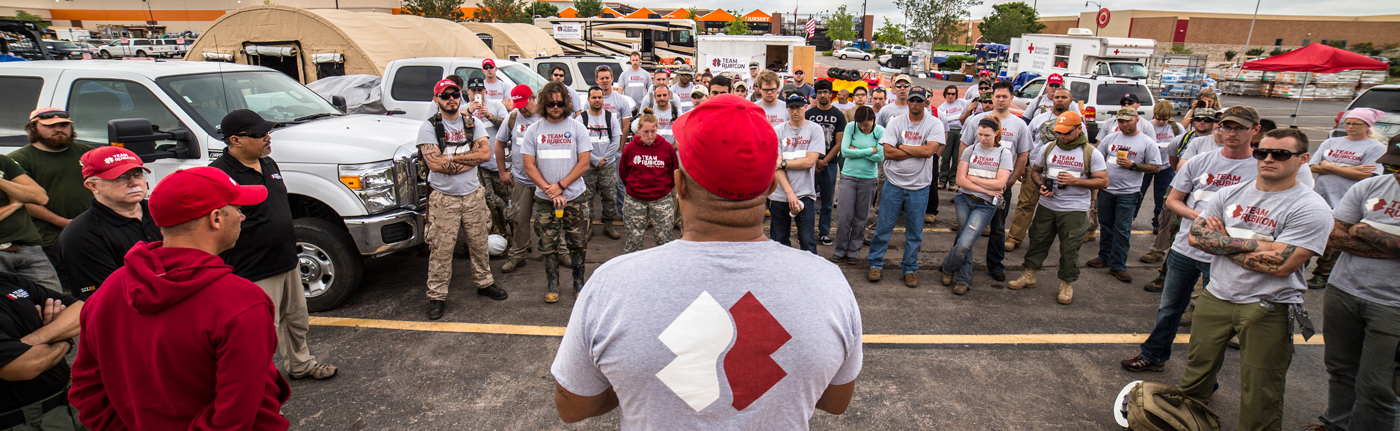 Team Rubicon volunteers gathered around and talking