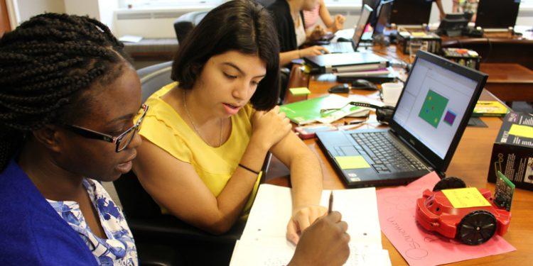 Girls learning code through Girls Who Code