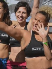 women in Dare to Bare sports bras celebrating at a fundraising event
