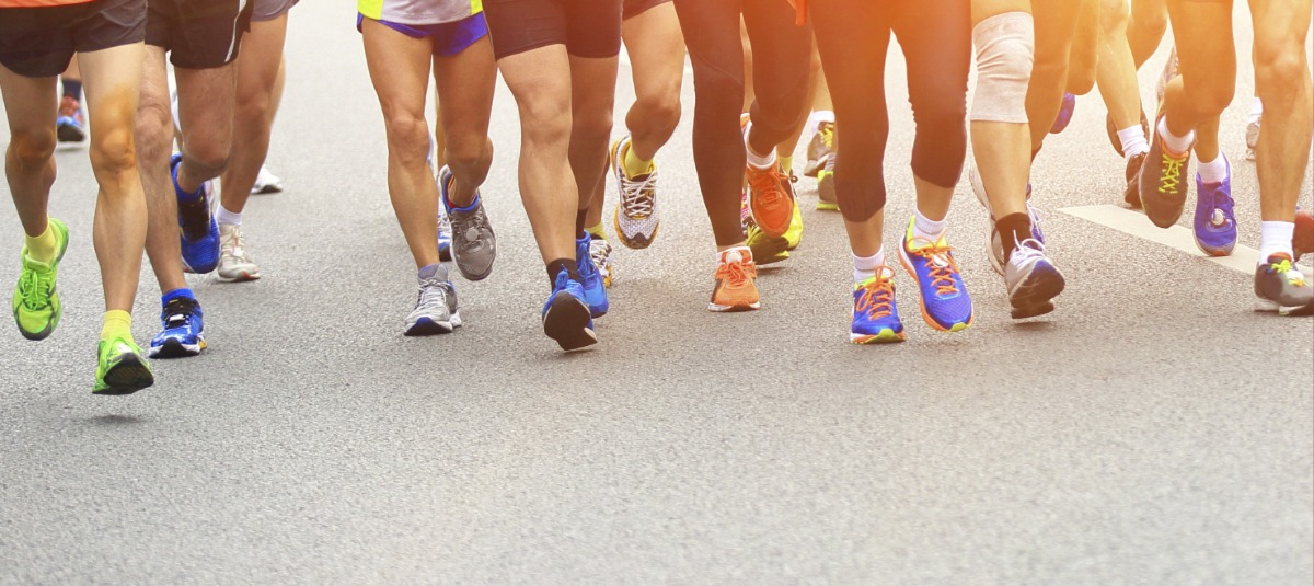 runners feet running at a fundraising event with colorful sneakers