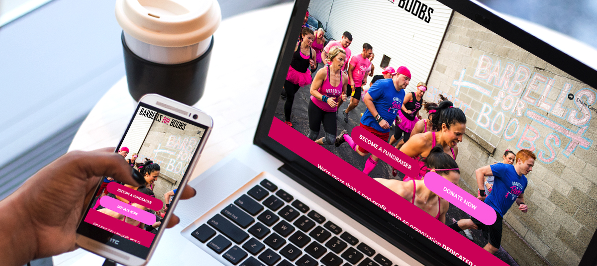 Barbells for Boobs campaign on a computer and a mobile phone next to a coffee