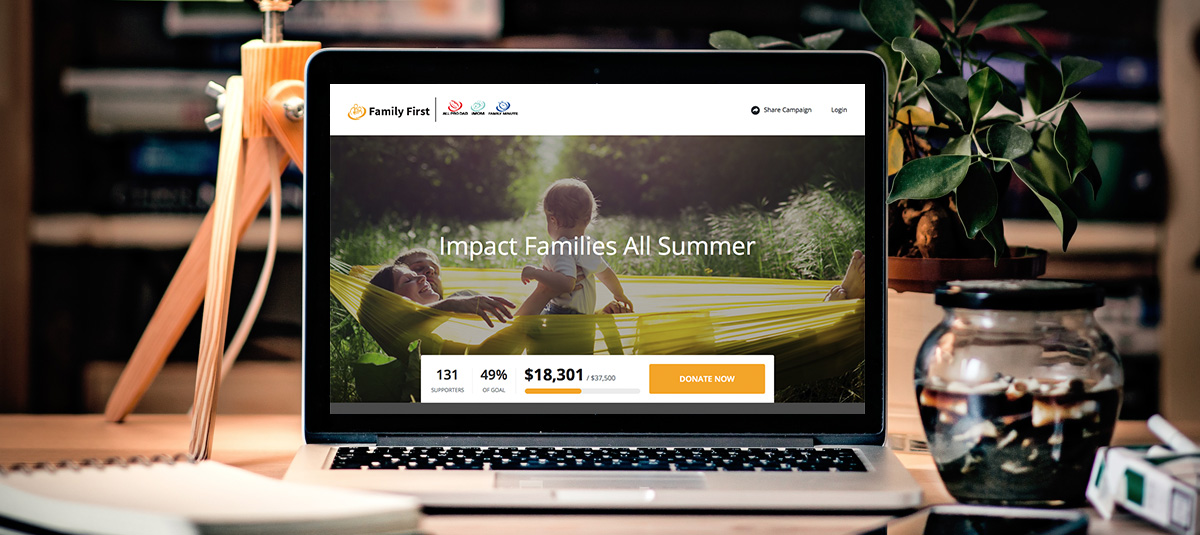 Family First crowdfunding landing page on a laptop