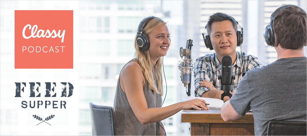 blonde woman wearing headphones sitting at a table with a microphone recording a podcast