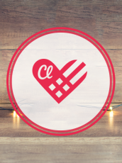 Classy giving tuesday logo with holiday decorations around it