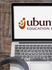 Classy podcast banner with Ubuntu logo on a laptop screen