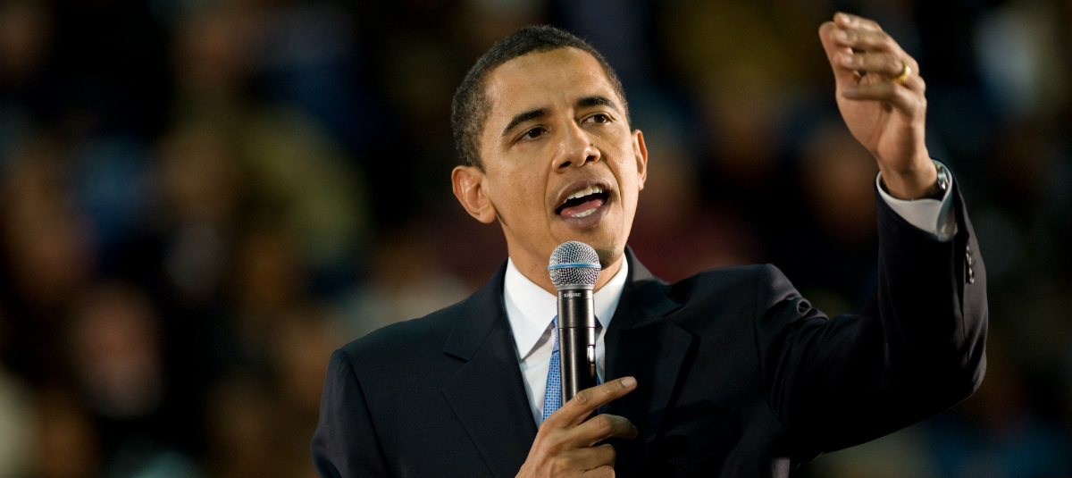 President Barack Obama speaking into a microphone