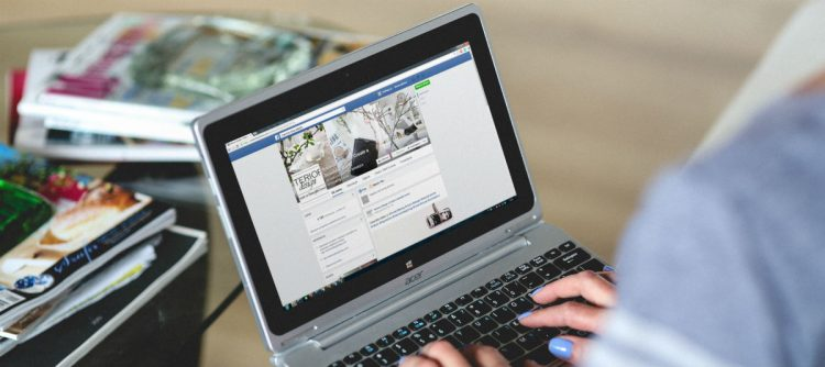 Facebook pulled up on a laptop screen