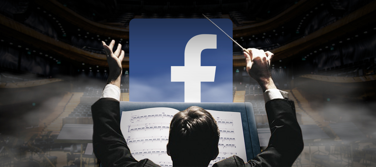 conductor conducting music with the facebook logo in the background