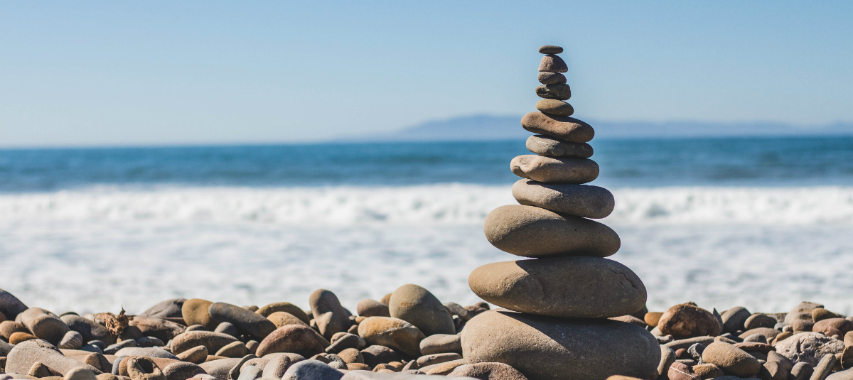balanced stack of rocks on the beach
