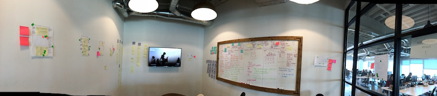 A design sprint's aftermath includes lots of stickies and whiteboard drawings.