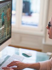 Woman working on fundraising page on desktop screen