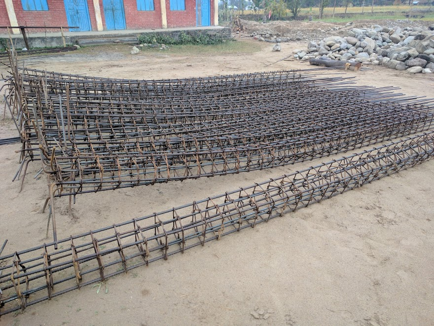 Groups of rebar, tied together.