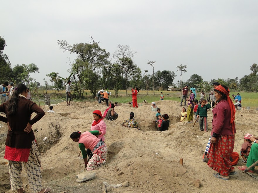 The entire village digging the foundation for the school.