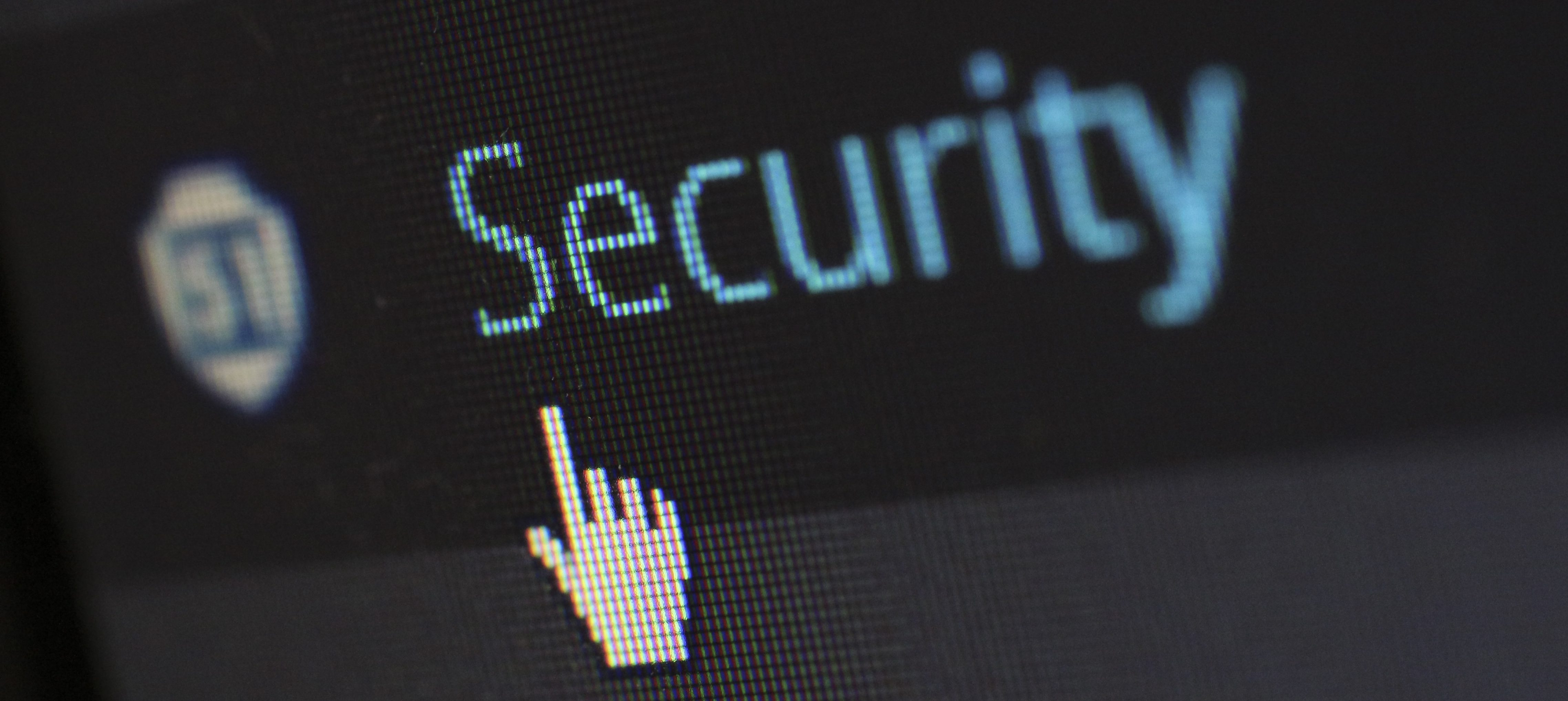 computer screen mouse pointing at the word security