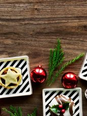 holiday party decorations against wood background