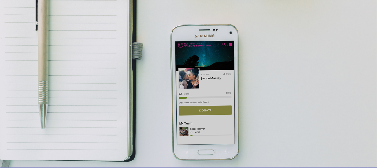 mobile phone open to a peer-to-peer fundraising page with a notebook and pen next to it