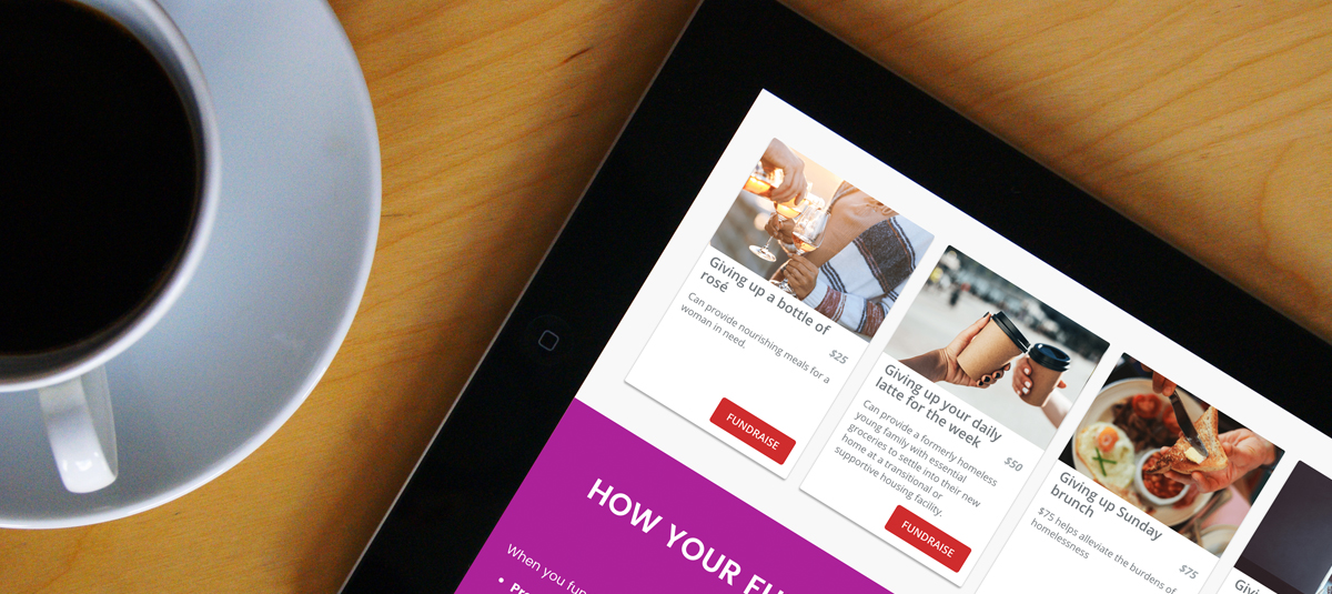ipad with a fundraising page open and a cup of coffee on a wooden desk