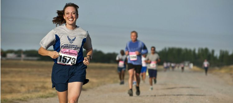 Image of woman running the air force marathon