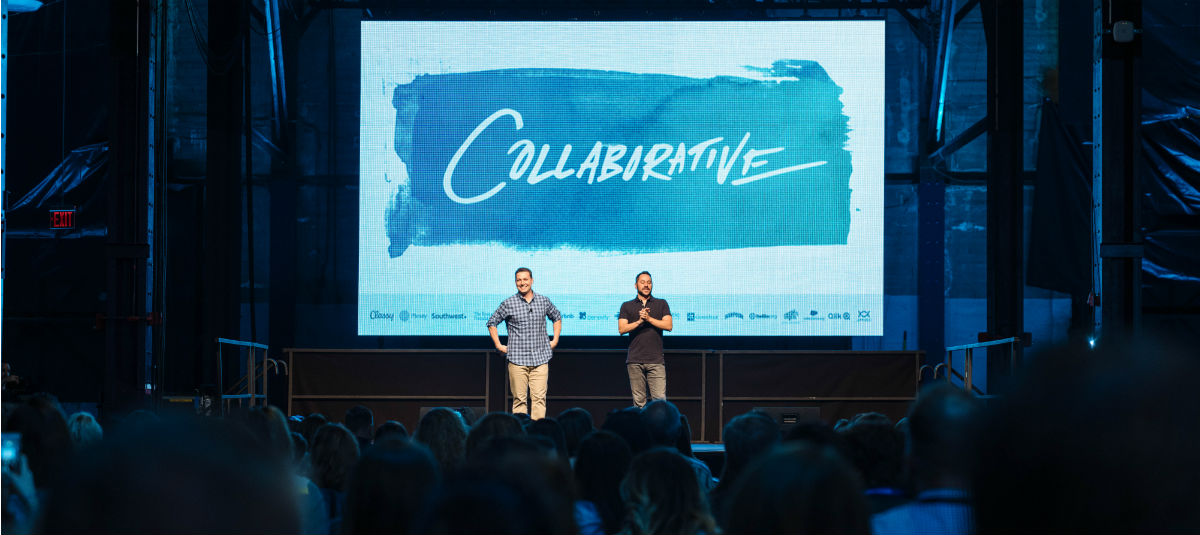 speakers at the main stage addressing an audience at the Collaborative 2019
