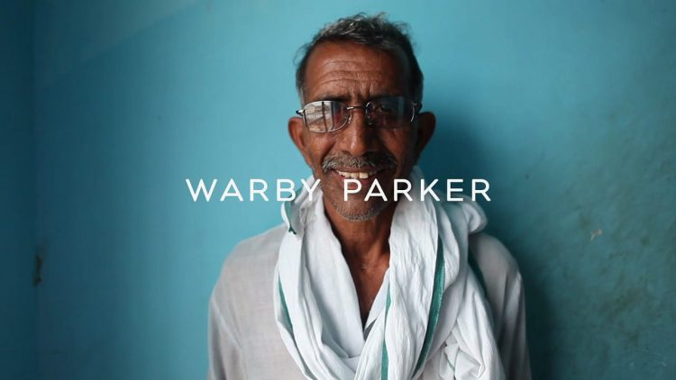 warby parker logo with photo of man in glasses