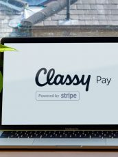 laptop with classy pay logo on screen