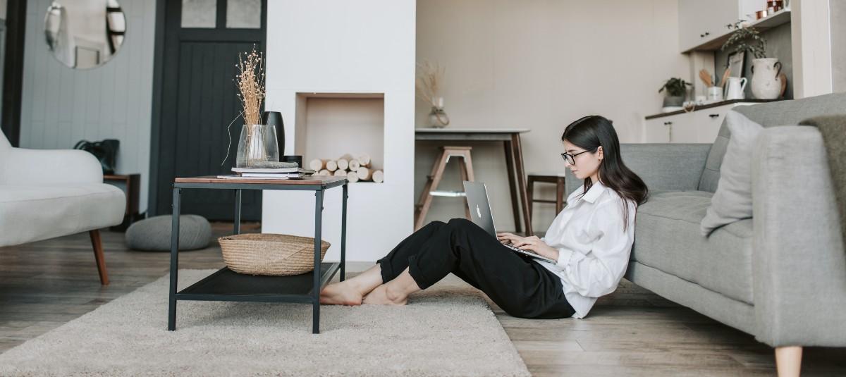 girl sitting on floor on her laptop