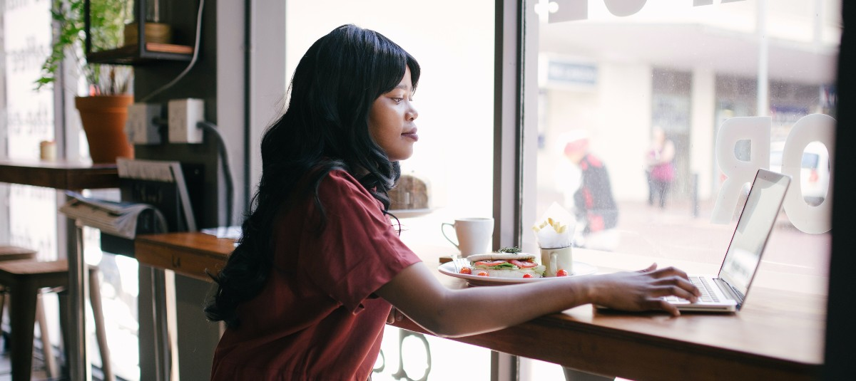woman at cafe on laptop