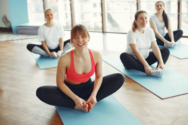 women stretching in yoga class